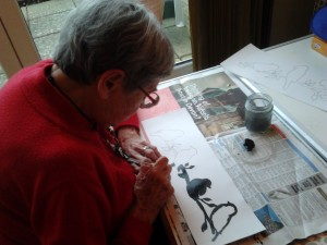 My mother enjoying painting in her care home